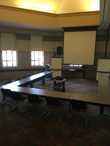 Meeting Room B with a U-shape set up, projector and screen