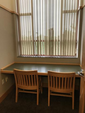 Study Room A with one rectangular table and two chairs facing the window