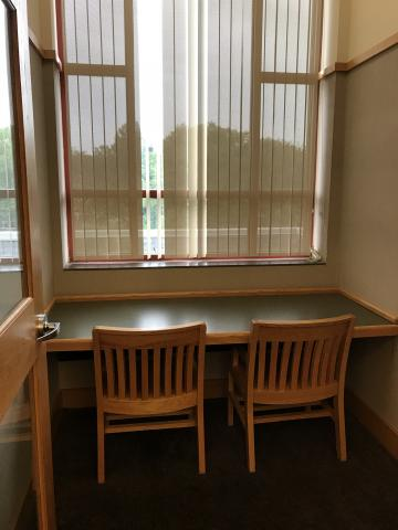 Study Room C equipped with one rectangular table and two chairs facing the window